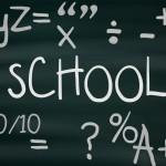 School blackboard with education symbols